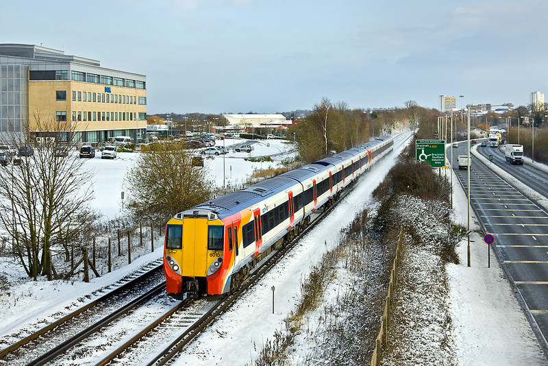18th Dec 09:  With snow on the ground 458010 leaves Bracknell with the 10.20 (2C25) from Waterloo to Reading