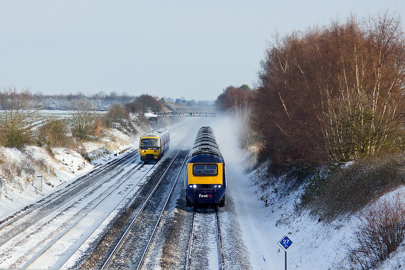 18th Dec 09:  The 12.18 Paddington to Taunton HST overtakes 165101 working 2R33 the 11.42 Paddington to Reading at Shottesbroooke