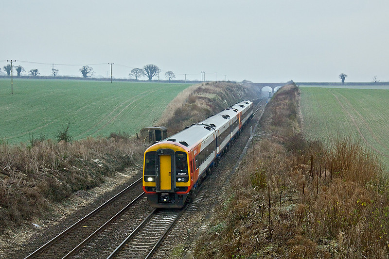 16th Dec 09:  The 08.20 from Waterloo to Exeter is formed of 159107 and has just started the drop down hill to the next stop at Andover