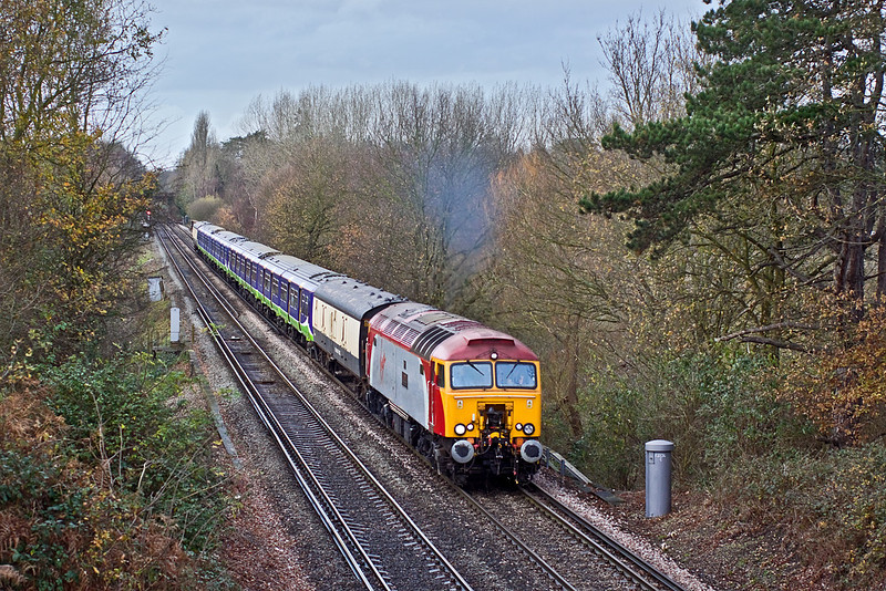 2nd Dec 09:  57302 is tasked with taking 321418 & 433 from Bletchley to Eastleigh for storage. Captured here passing through Lyne and having just crossed the M3