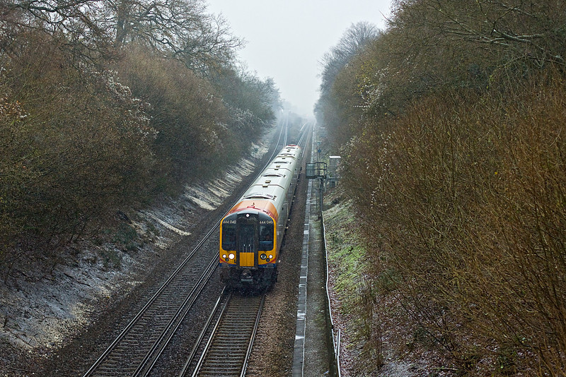 16th Dec 09:  2B39 is the 12.38 from Waterloo to Eastleigh today formed of 444040. captured here in a sleet storm just south of Battledown Flyover