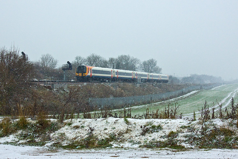 16th Dec 09:  1W65 is the 12.05 Waterloo to Weymouth.  With the snow getting heavier 444042  is running 2 minutes late as it passes Worting Junction