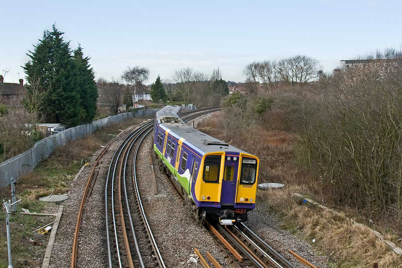 10th Feb 09:  313120 drops down the hill from Wembley Central and will pass under the WCML and on to Euston with the 13.21 from Watford Junction