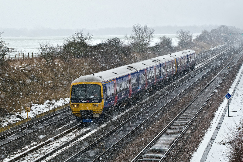 3rd Feb 09:  166221 works 2R31 from Paddington to Reading through a snow shower at Shottesbrooke