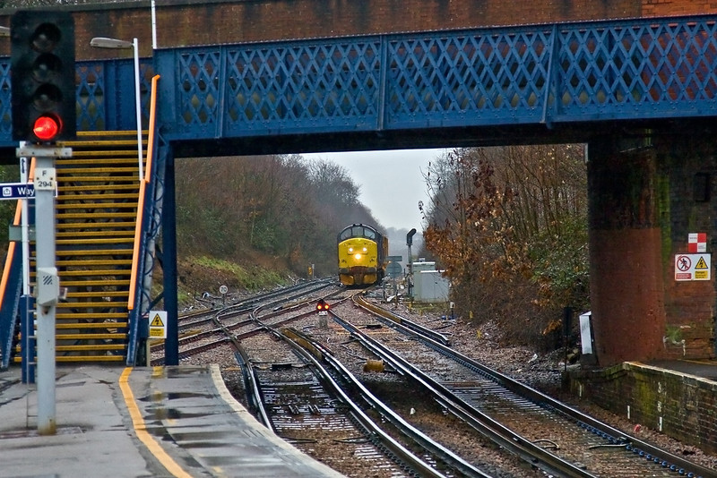 9th Feb 09:  37667  running from Ashford to Alton is about to turn off the Reading line at Virginia Water to gain the LSWR main line at New Haw