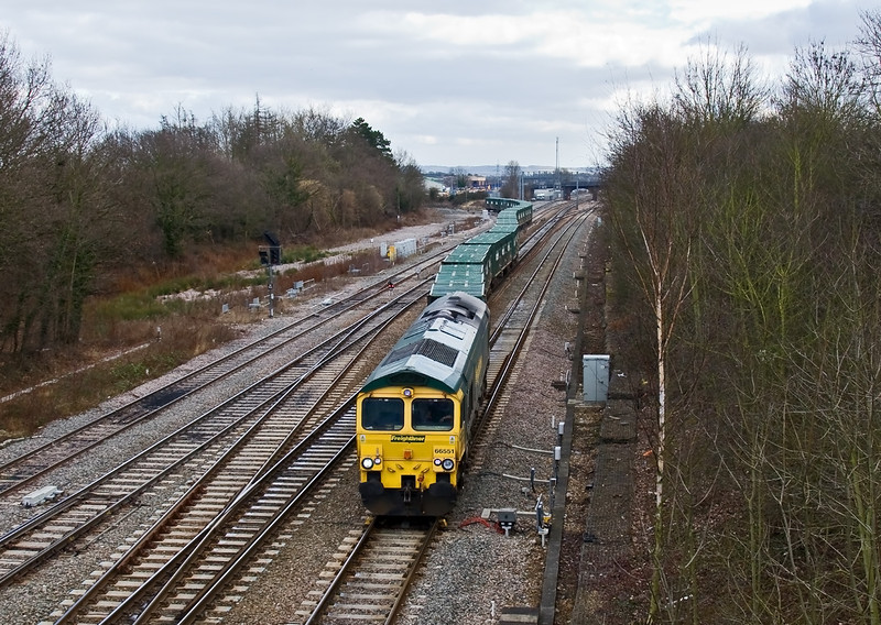 20th Feb 09:  The 10.55 from Calvert to Bath & Bristol empty Bin Liner with 66551 on the point snakes from Didcot's west curve onto the Dowm Main at Foxhall Junction
