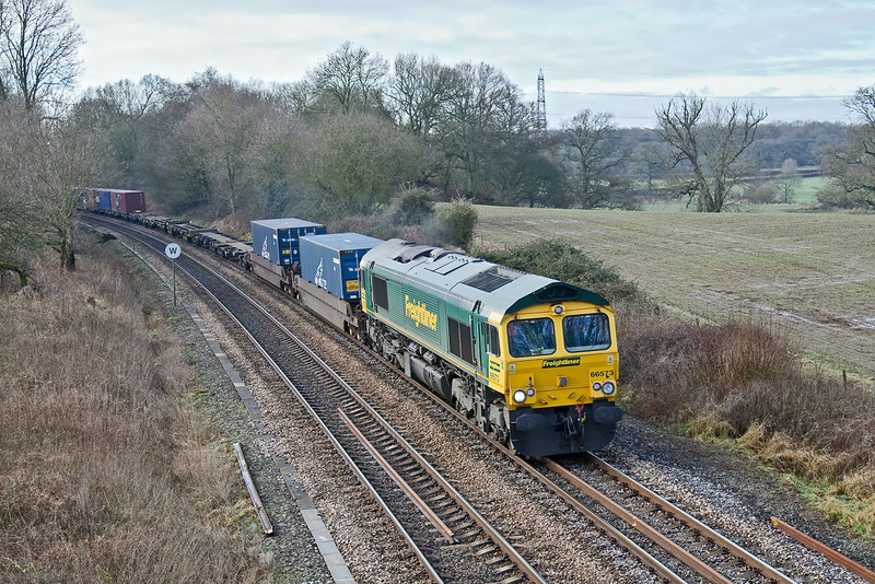 13th Feb 09:  The 08.58 from Southampton to Lawley Street powered by 66573 climbs through Silchester