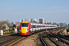 18th Mar 09:  460002 working the 11.45  to Gatwick (1D64) is about to run through Clapham Junction in glorious spring sunshine.