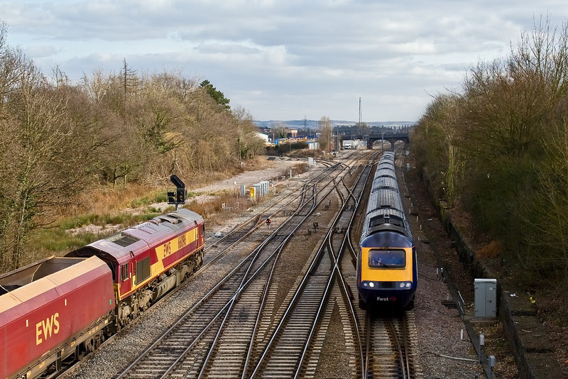 v20th Feb 09:  As 66096 exits the Power Station and waits the signal for permission to head to the station and run round  the 13.15 to Cardiff gets away to the west after the Didcot stop. Captured here at Foxhall Junction
