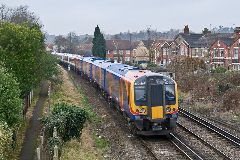 15th Jan 09:  The unusual combination of a High Capacity 450567 and 444044 leave Egham on an ECS working.  Shame about the dire light though.