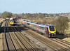 21st Jan 09:  Cross Country Voyager 221214 over taking 66570 working 4O51 from Wentloog to Southampton at Lower Basildon