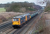 21st Jan 09:  59005 approaches the bridge at Frouds Lane  just east of Woolhampton powering 7A17 from Merehead to Acton