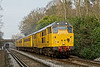 """30th Jan 09:  """"The yellow train"""". Leaving Virginia Water is Network Rail's 31285 working 1Q12 on a roundabout trip of West Surrey and North Hants. The rear of the Hoo engineers train can be seen under the bridge."""