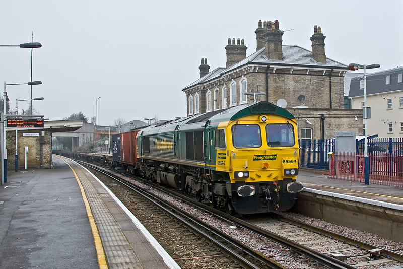 10th Jan 09:   With the temperature well below freezing the diverted via the WCML, due to engineering work in the Oxford area,  4O27, 05.29 from Garston to Southampton crawls through Chertsey Station.