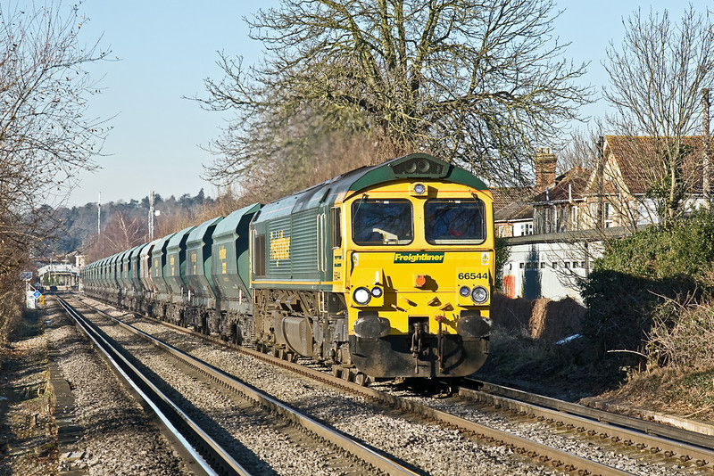 6th Jan 09:  66544 heads 6O49-1018 Neasden to Wool sand empties across Addlestone Moor and away from Chertsey