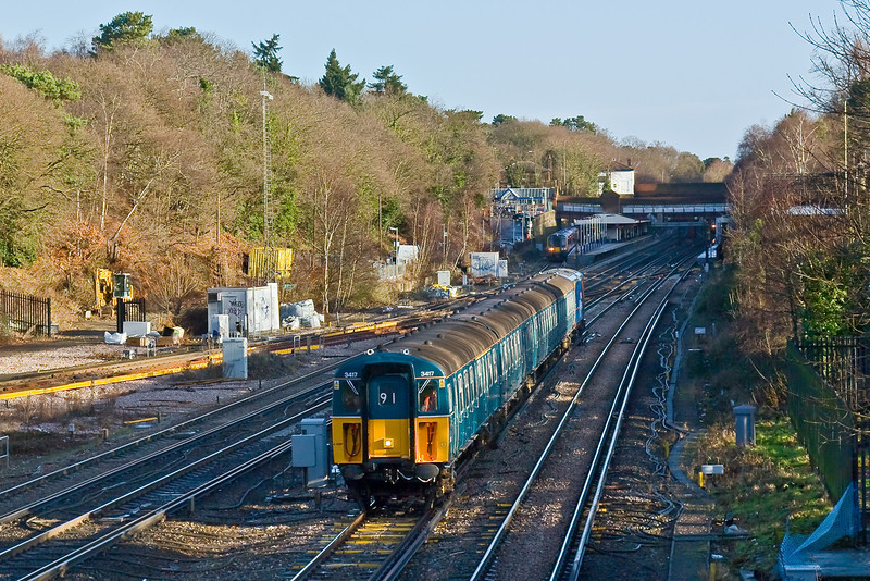 17th Jan 09:  4VEP 3417 on her last run on BR metals leaves Weybridge heading for Woking.  From there it will head to East Grinstead for Preservation on the Bluebell Railway
