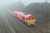27th Jan 09:  Emerging from the mist the newly repainted into GB Schenker red 59206 shows up very well as it powers 7A09 from Merehead to Acton