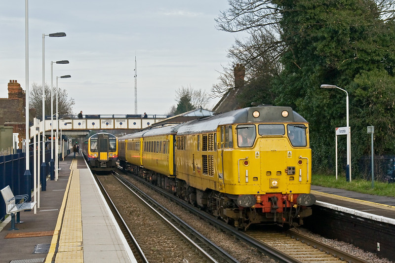 30th Jan 09:  31285 heads 1Q12 south through Farncombe on the days Circular tour of West Surrey and North Hampshire. Sitting in the platform is 450029 with 2P44 the 13.39 Haslemere to Waterloo.