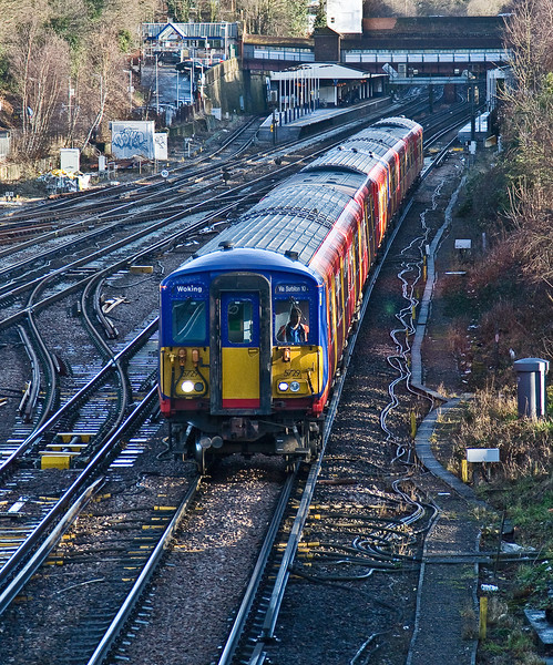 17th Jan 09:  455729 leads away from Weybridge with  2F17, the 0922 from Waterloo to Woking