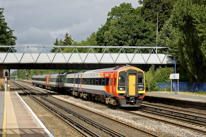 5th Jul 09:  159018 forms 1L24 the 07.32 from Yeovil Junction to Waterloo and is seen here racing through Fleet