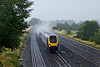23rd July 09:   In torrential rain the 11.27 from Manchester Piccadilly to Bournemouth passes through Lower Basildon
