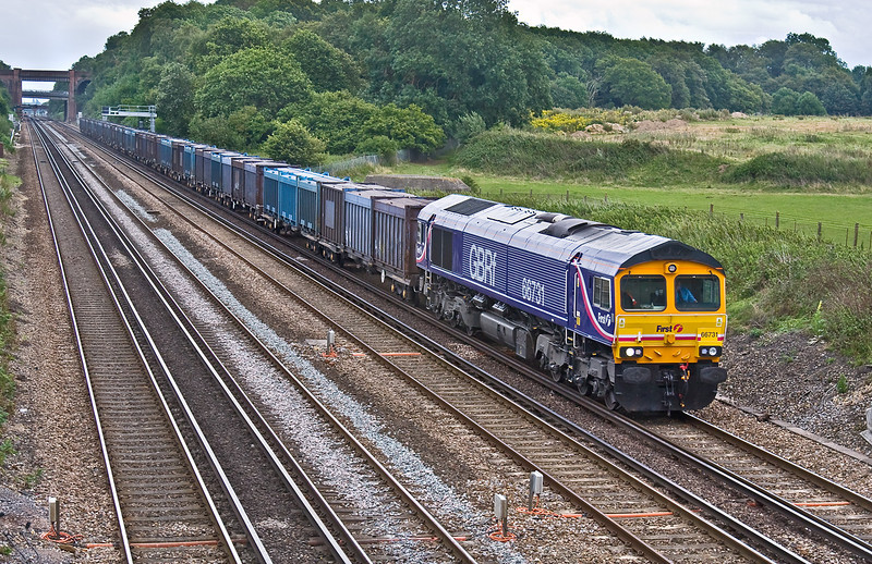 29th Jul 09:   The Mountfield to Southampton empty Gypsum Containers now runs only very occasionally.  Today was one of those occasions, 66731 brings 4Y41 along the slow at Totters Lane near Winchfield