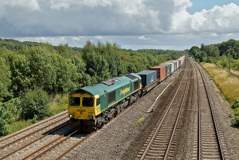 23rd July 09:   Roaring through Lower Basildon is 66589 in charge of 4M61 from Southampton to Trafford Park in Manchester.