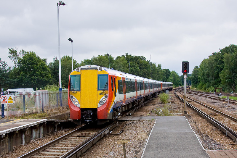 11th Jul 09:  458012 arrives at Ascot's platform 1 with 2C37 the 13.20 Waterloo to Reading on a very dull day. Track renewal work on the line to Bagshot had closed the rest of the station preventing trains to Reading from using the usual platform 2