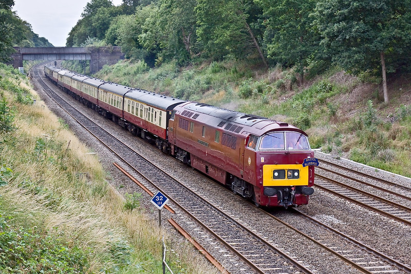 10th Jul 09:  Class 52 D1015 Western Champion, on her old stamping ground the Great Western main line,  runs through the Sonning Cutting  5Z52 was working from Eastleigh to Old Oak Common with the ECS for the GBRf staff outing to Minehead on Saturday morning.
