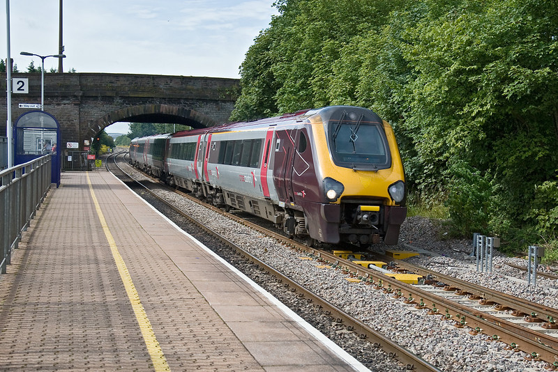 28th Jul 09:  Voyager 221121 scoots through Yate working 1M33 the 10.00 from Bristol Temple Meads to Manchester Piccadilly