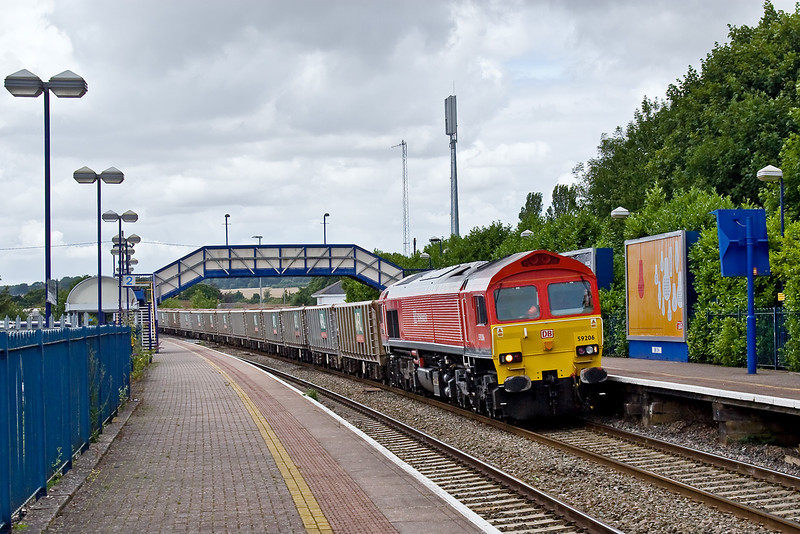 31st Jul 09:  In deadly dull light 59206 trundles through Hungerford with 7A17 from Merehead to Acton