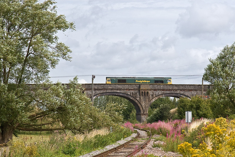 28th Jul 09:  66573 and the Wentloog to Southampton liner (4O51) crosses over the old Midland Main Line from Bristol to Birmingham at Westerleigh