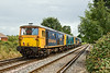 24th Jul 09:  0Y68 was to move 3 EDs 73206/208/204 from St Leonards to Eastleigh. A stop at Tonbridge was made for 66402 to join the consist.  Captured here on Addlestone Moor