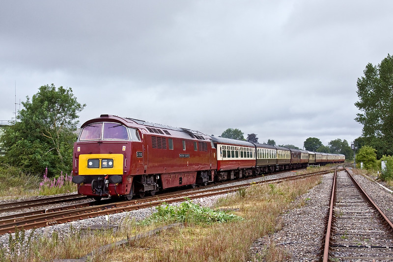 11th Jul 09:  In charge of the GB Railfreight staff jolly from Paddington to Minehead (1Z52) is Class 52  D1015 'Western Champion'. Sounding great and going well she is seen here at the foot crossing in Padworth