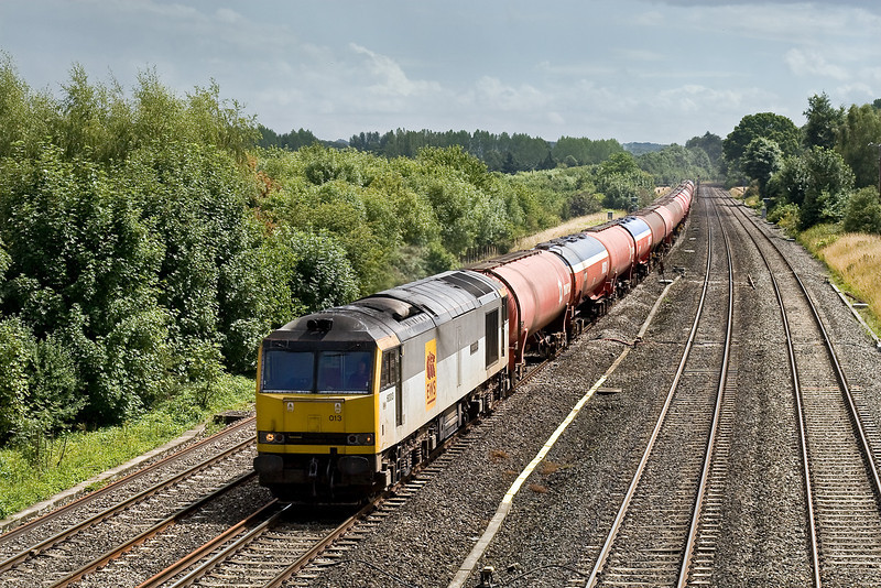 23rd July 09:   In a fortunate sunny spell 60013 heads west with the empty Murco tanks from Theale to Robeston (6B33). This train is often routed down on the Main Line so even more luck when it came on the Relief.