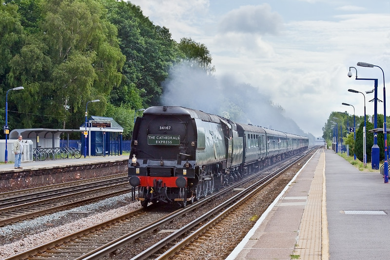 5th Jul 09:  34067'Tangmere' races through Fleet while working 1Z92 from Waterloo to Exeter