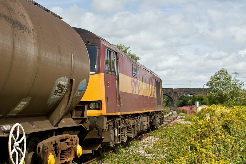 28th Jul 09:  Leaving 30 minutes early 60019 and 6E41 from Westerleigh to Lindsey is about to pass under the Great Western Main Line to South Wales.