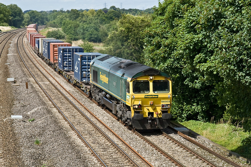 23rd July 09:   66503 is on the point of 4O27 from Basford Hall to Southampton. Captured here at Lower Basildon.