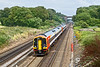 29th Jul 09:  159005 is working 1L41 the 14.20 from Waterloo to Paignton rushes down the slope between Winchfield and Hook