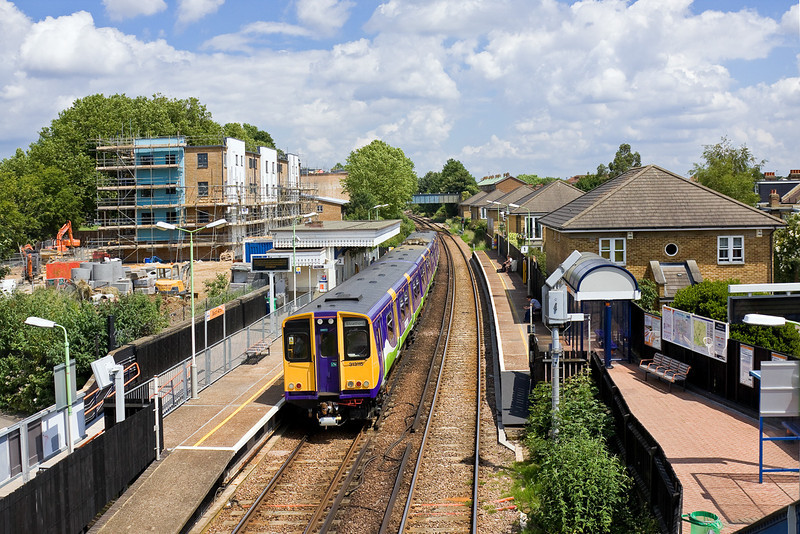 13th Jun 09:  313115 forms the 13.27 from Richmond to Stratford (2N66). Captured here at  South Acton.