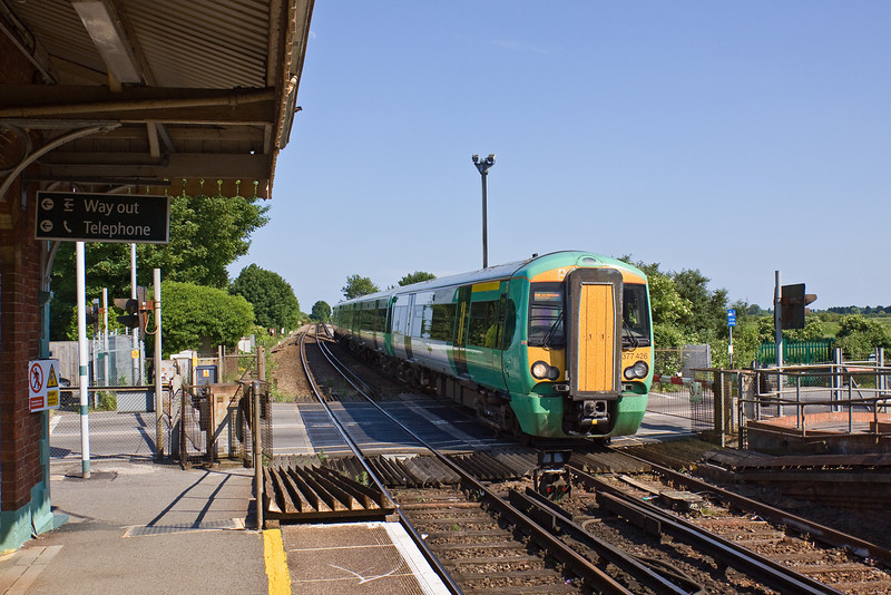 1st Jun 09:  The 15.02 from Victoria to Portsmouth Harbour runs over the level crossing and through Ford to it's next stop at Barnham.  1C28 is formed of 377426