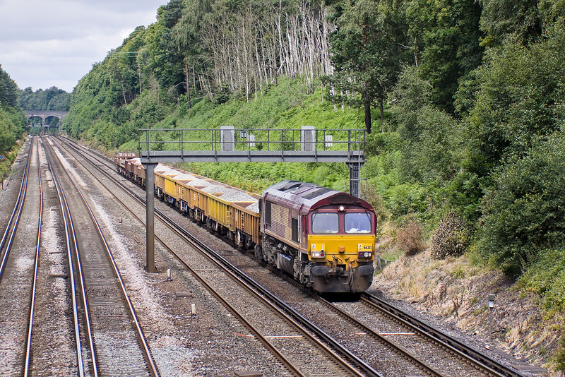 21st Jun 09: 66213 trundles up the slow line through Pirbright with a load of ballast. 6N09-09.40 Eastleigh E Yard to Balham