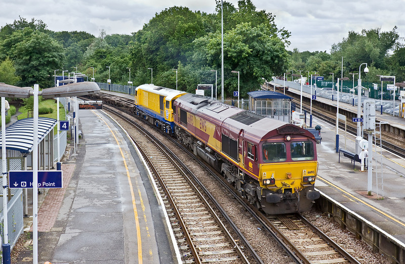 10th Jun 09:  Newly refurbished 58018 in TSO's bright yellow livery is being moved from Eastleigh to Wembley. 6M44 is powered by 66193 and is pictured here passing through Platform 3 at Virginia Water.  Many thanks to 'Western Enterprises' for the post saying that this move was taking place.