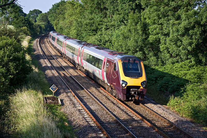 29th Jun 09:  In soft evening light 221132 heads south with 1O54 the 15.27 from Manchester Piccadilly to Bournemouth through Silchester