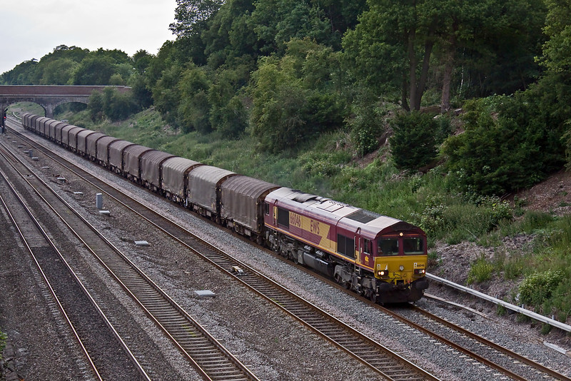 8th Jun 09:  66046 is in charge of 6Z98 loaded IHA steel carriers from  Margam to Dollands Moor. Seen Here at Southbury Lane in Ruscombe