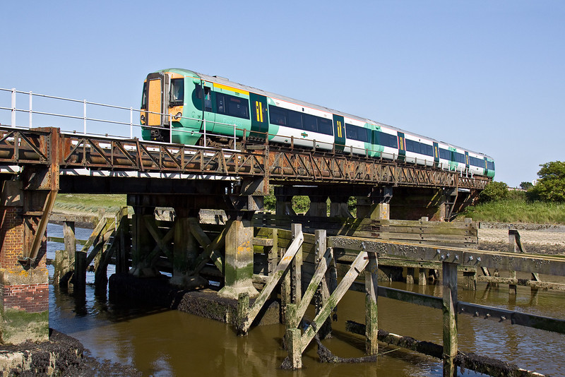 1st Jun 09:   377323 forming the 15.33 from Brighton to Southampton Central (1Y20). Captured here on the bridge at Ford where the line crosses the River Arun