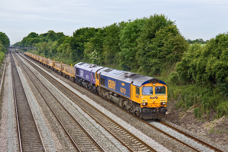 12th Jun 09:  The Taunton Fairwater Yard to Whitemoor scrap sleepers (4L31) trundles through Shottesbrooke powered by 66701 'Whitemoor',  DIT is 66730 which had previously worked locomotives from the Long Marston open day to the West Somerset Railway.