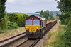21st Jun 09: 66142 nears Farncombe with empty ballast wagons