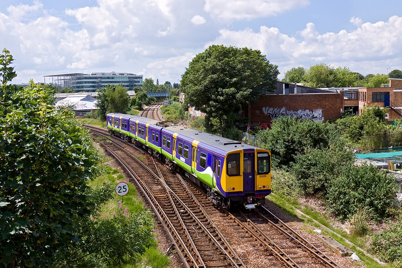 13th Jun 09:  313115 forms the 13.27 from Richmond to Stratford (2N66). Captured here on the approach to South Acton