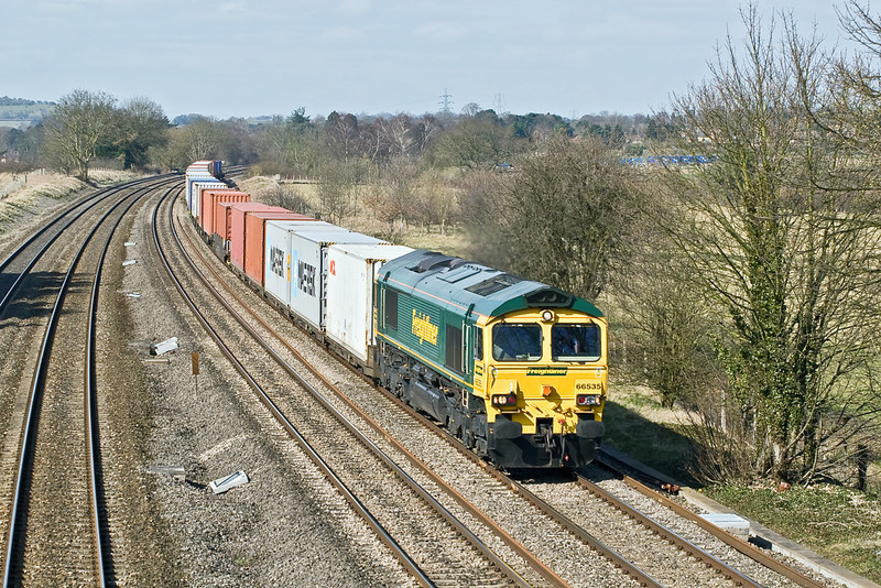 11th Mar 09:   The 06.13 from Leeds to Southampton rushes through Lower Basildon headed by 66535